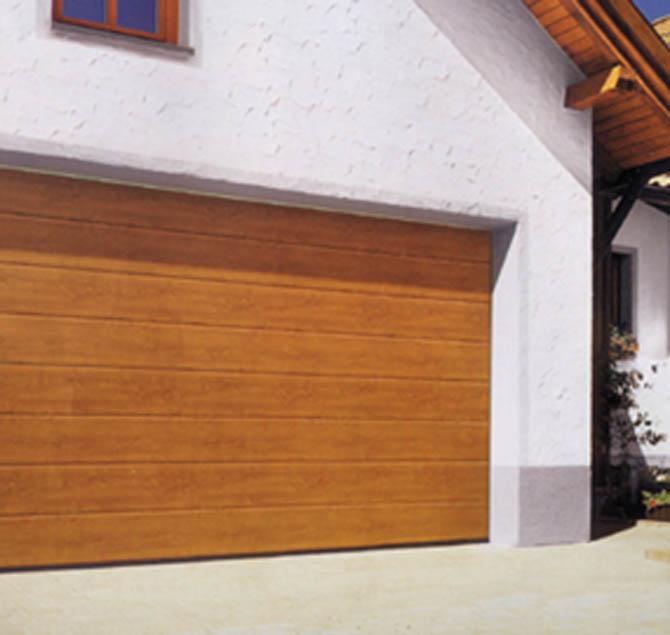 欧式方块翻版车库门/仿木纹式车库门/安徽车库门生产厂家 1、微电脑程序控制,使用方便,按遥控手柄即可,且电机自带自动延时照明灯。 2、超级静音,绿色环保。 3、停电有应急锁,开关容易。 4、安全、牢固,双层彩钢板,门板总厚度4-5公分,门体中间采用国际公认的保温隔热隔音材料聚胺酯。 5、美观、高雅,简洁大方。 6、遇阻反弹,保证人车安全。 7、原理科学,门内置扭簧,扭力和门重量相当,使门体处于零重量状态,且在轨道内靠滑轮运行,故阻力小,耗能少,维修率低,经久耐用。 8、零部件拆卸及更新方便,有利于维