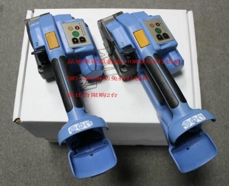 电动打包机工作原理:将塑钢带或塑料打包带,从上往下缠绕捆包物体一